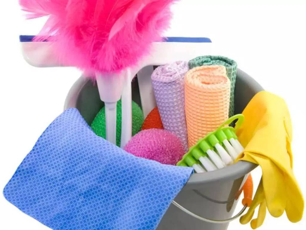 a mop bucket with various cleaning supplies
