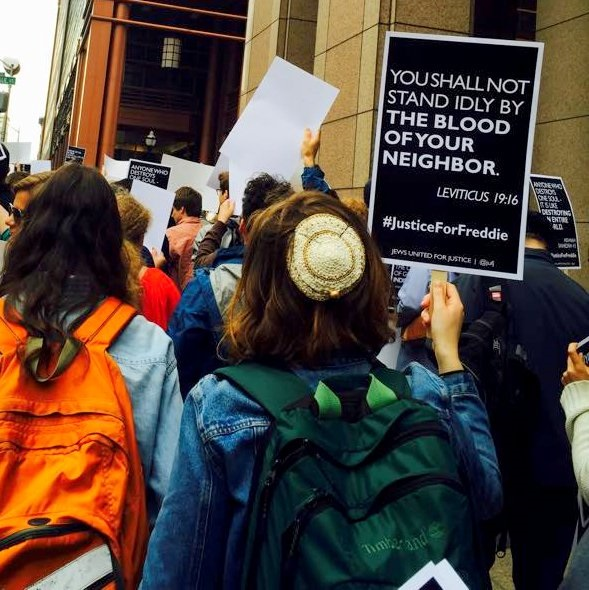 JUFJ members protesting police reform in Baltimore