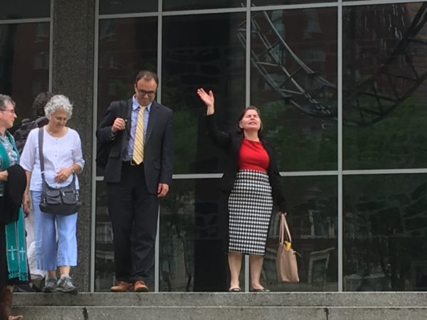 Marta celebrates not being deported on steps of court