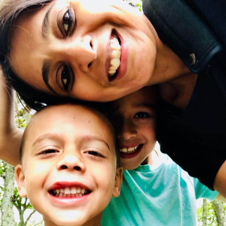 A mother with two children smiling