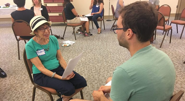 JUFJ members discuss a reading in pairs.