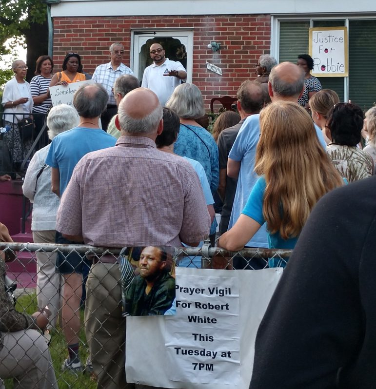 A group of people gathered for the Robert White vigil