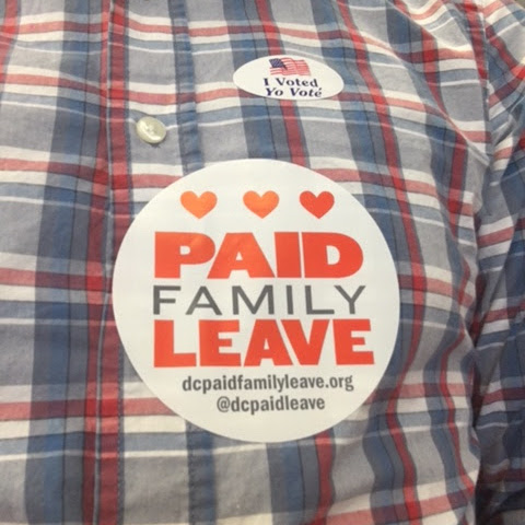 photo of someone wearing a paid family leave sticker