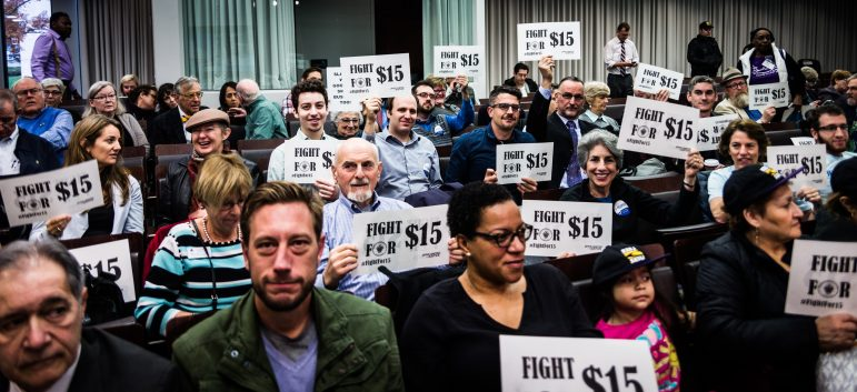 fight for 15 activists holding signs