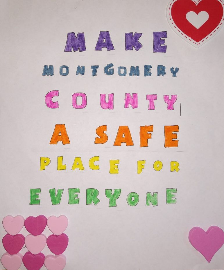 a hand drawn sign reading make montgomery county a safe place for everyone