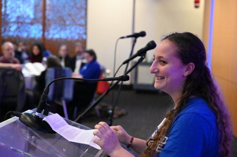 woman smiling at podium
