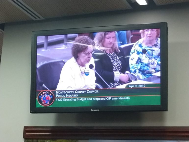 photo of a tv displaying moco county council public hearing