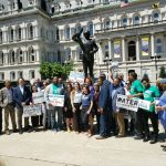 water justice advocates pose for photo