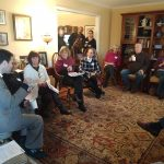 district 14 legislator meeting, people in a circle in a cozy home