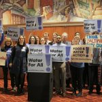 advocates pose after fighting for water justice