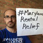 Dan Richman holds a sign: #MarylandRentalRelief