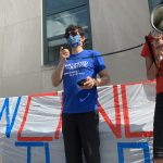 JUFJ leader Joe Magar speaks at a cancel the rent rally
