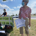 JUFJer holds a sign: We mourn with communities torn apart by ICE